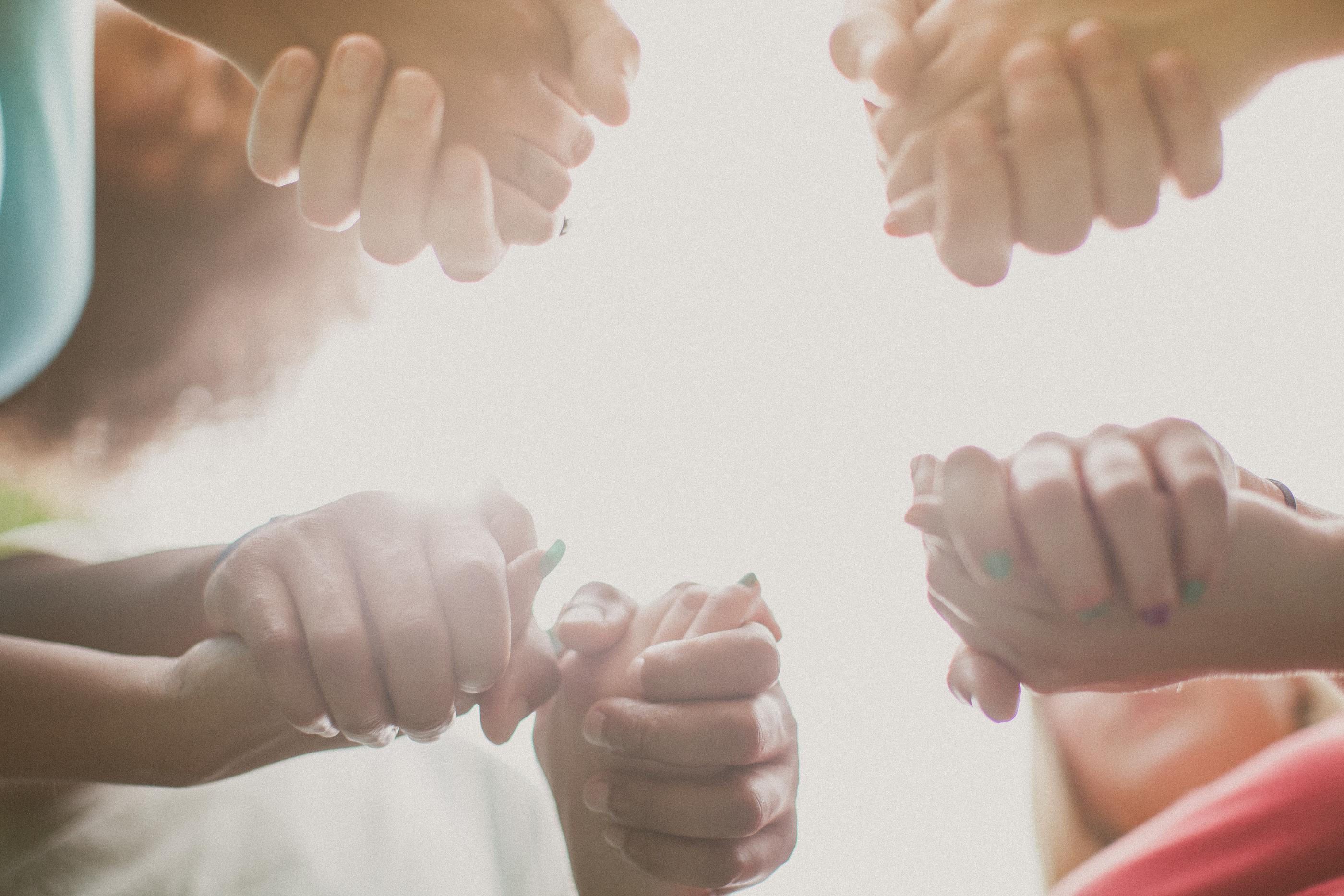 family praying hands